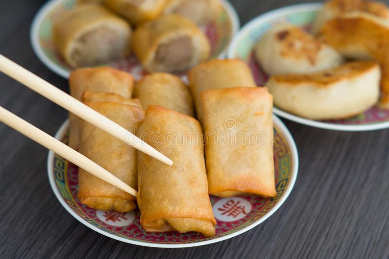 Picking up Spring Rolls with chopsticks royalty free stock images