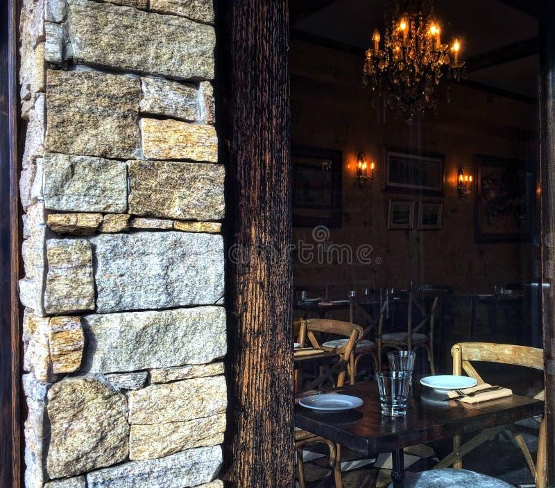 Picking through window at cozy restaurant interior stock images