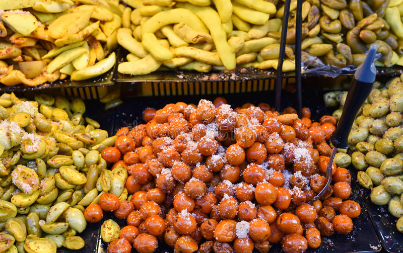 Pickle fruit - Preserved fruits. Pickle fruit for sale In the market Thai street food. mango tamarind Madman star gooseberry royalty free stock photo