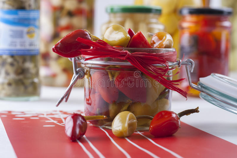 Pickle Jar. Winter ideas - taste of summer on your table: pepper in the oil stock image