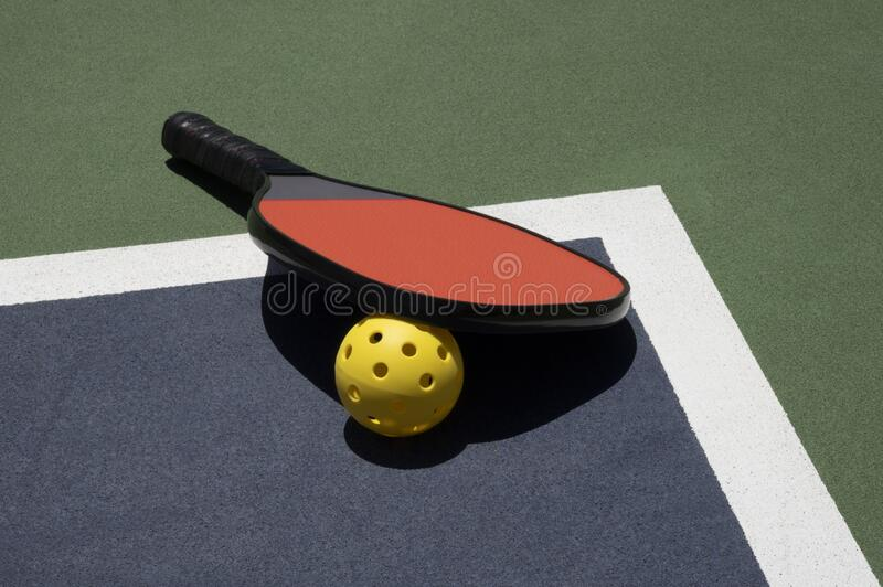 Pickleball Time Out with Ball and Paddle on Court stock images