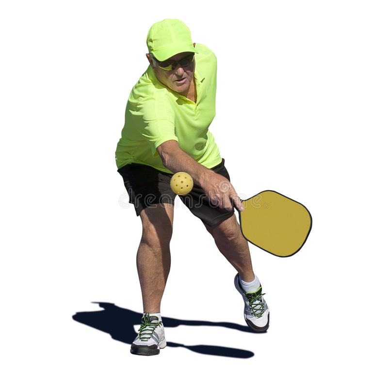 Pickleballactie - Hogere Mannelijke Speler die Backhand raken royalty-vrije stock afbeeldingen