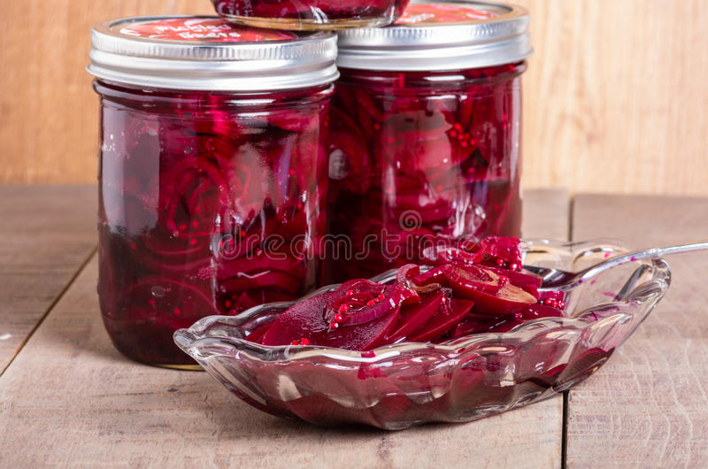 Pickled beets in jars and bowl royalty free stock photo