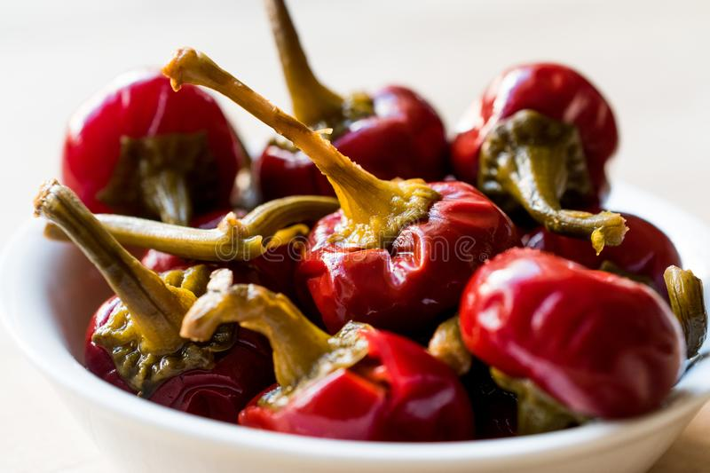 Pickled Cherry Pepper Pickles in bowl. stock photos
