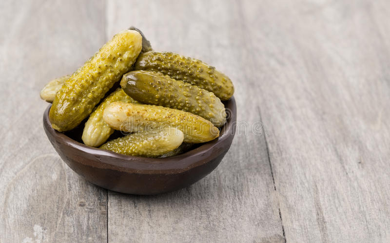 Pickled cucumbers in bowl stock photography