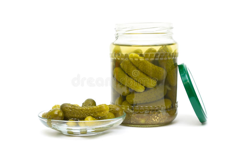 Pickled cucumbers close-up on a white background. horizontal photo. Pickled cucumbers close-up isolated on a white background. horizontal photo royalty free stock photos