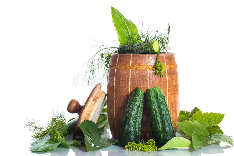 Pickled cucumbers. Pickles with spices in a wooden barrel stock image
