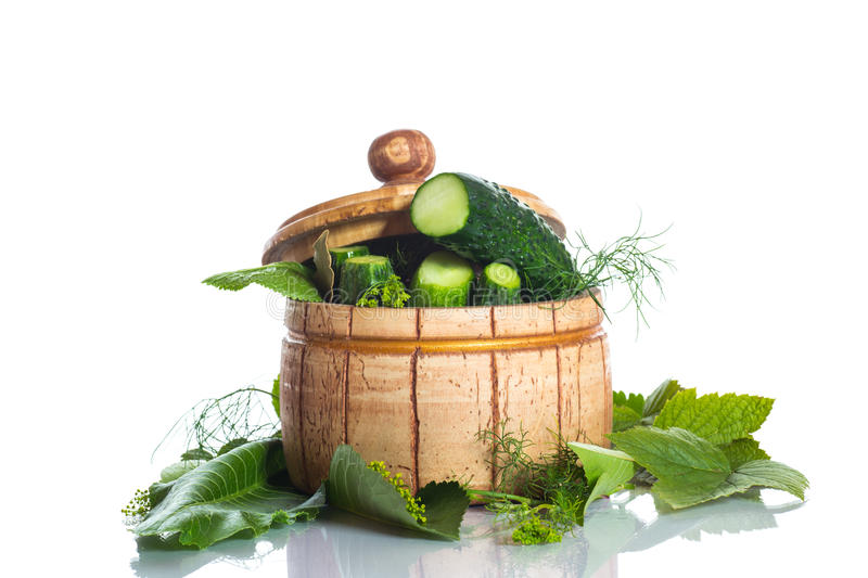 Pickled cucumbers. Pickles with spices in a wooden barrel royalty free stock photo