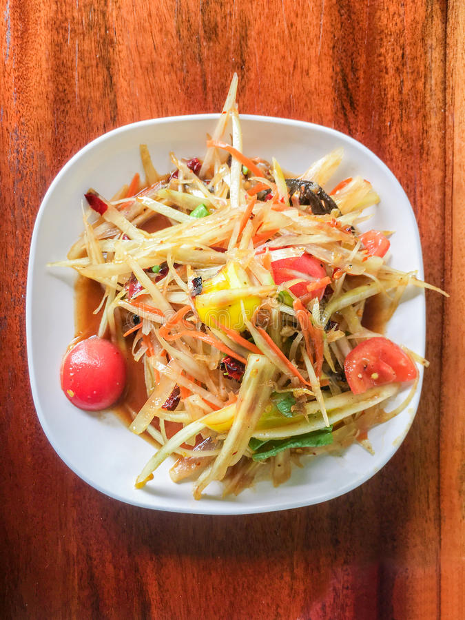 Pickled fish papaya Salad, Som tum, Thai food on wood table royalty free stock images