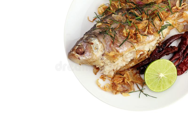 Pickled fish tasty fried pla som tod : thai word, pickled fish fry and fried onion, lime slice, and fried chili served stock photos