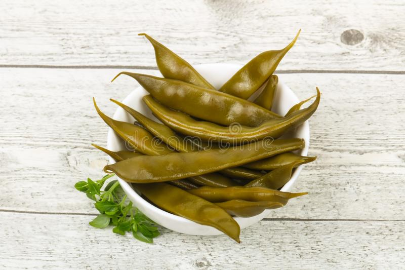 Pickled green bean. Heap in the bowl royalty free stock photos