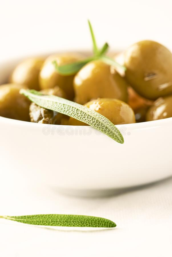 Pickled green olives and gherkins. Close up. royalty free stock images