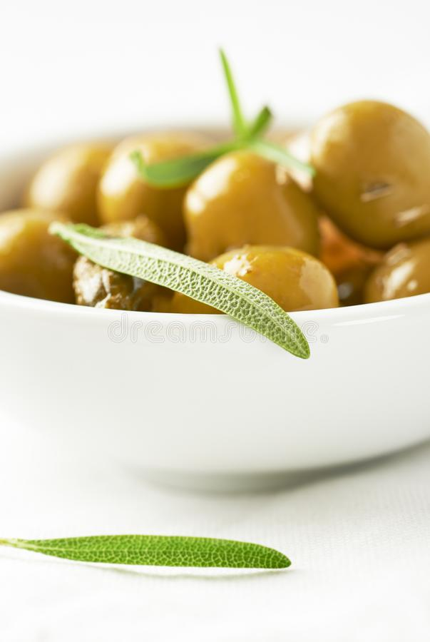 Pickled green olives and gherkins. Close up. stock image