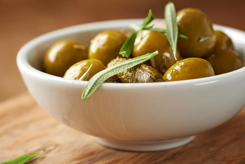 Pickled green olives and gherkins. royalty free stock photography