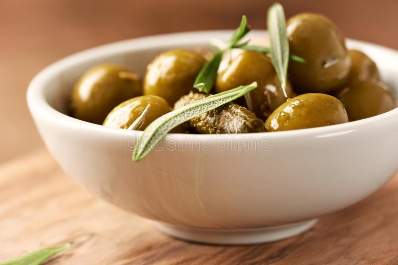 Pickled green olives and gherkins. royalty free stock photo