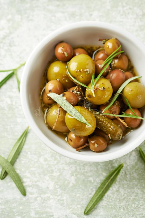 Pickled green olives and gherkins. stock photos