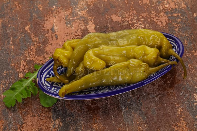 Pickled green pepper stock images