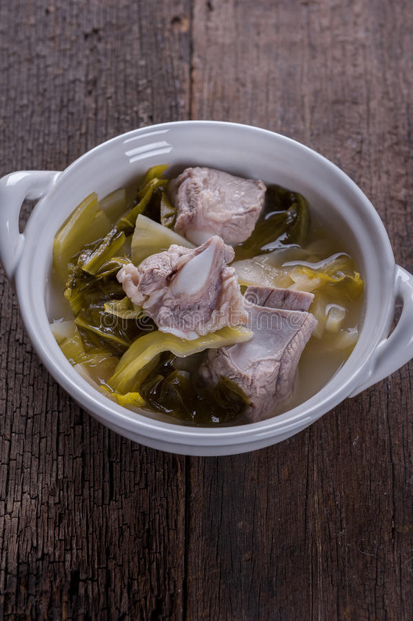 Pickled lettuce soup with pork. On the wooden table stock photography