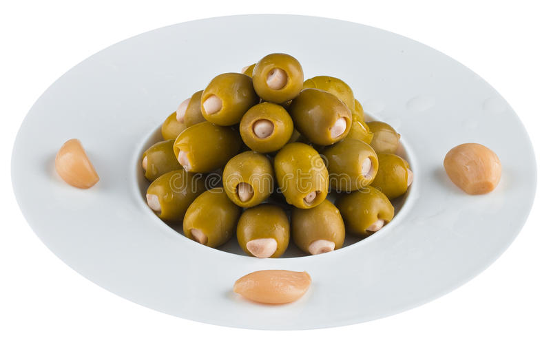 Pickled olives in white plate stock photography