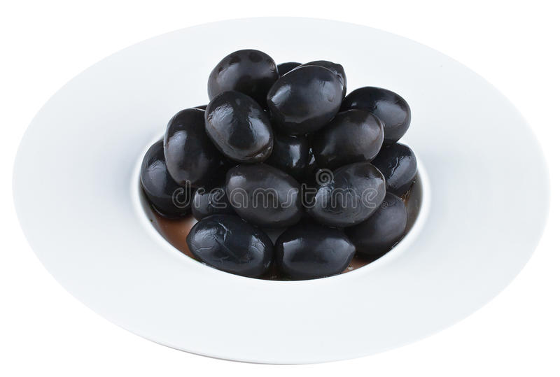 Pickled olives in white plate stock images