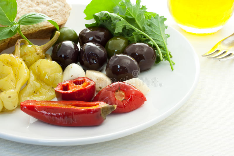 Pickled peppers and olives royalty free stock photos