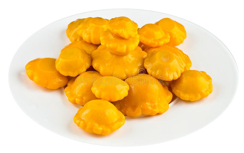 Pickled squash in white plate stock image