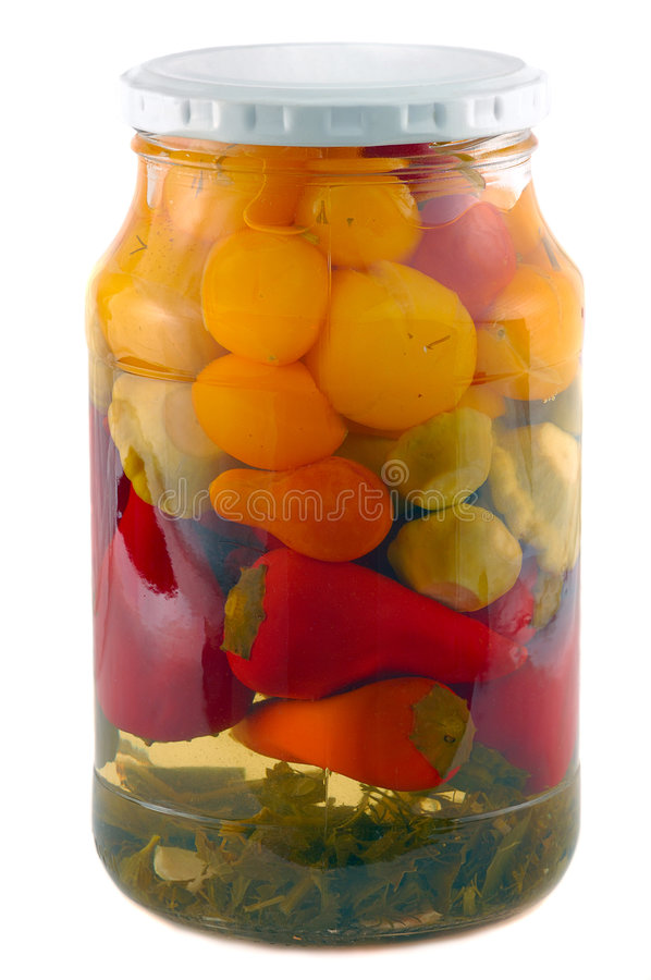 Pickles. Glass jar with marinated vegetables isolated on white stock photography