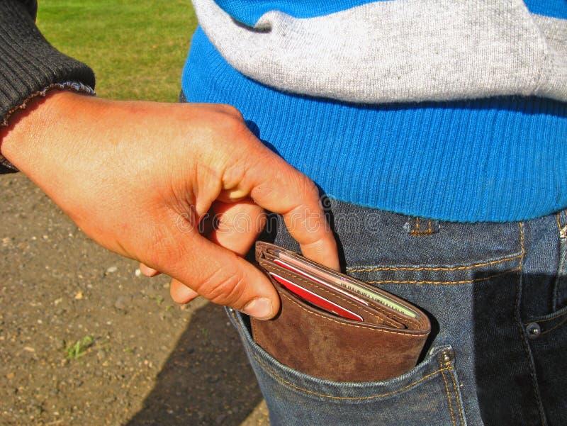 Download Pickpocket 2 stock image. Image of money, pick, hand - 26603645