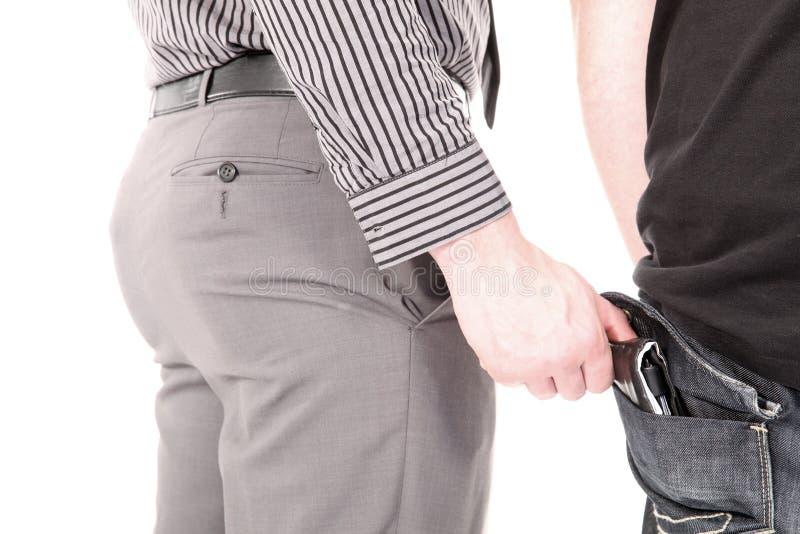 Pickpocket volant un portefeuille images stock