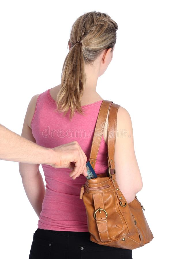 Pickpocketing a Creditcard out of a handbag royalty free stock photos