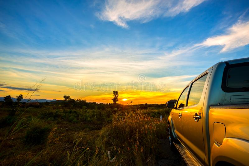 The pickup car parked in the meadow field royalty free stock photography