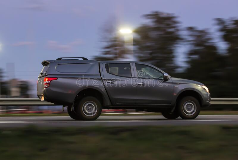 Pickup rides around the country in the evening stock photo