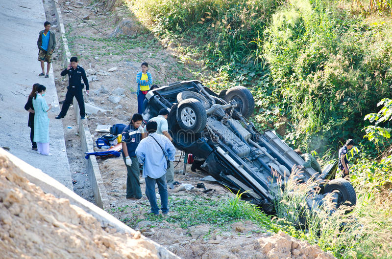 Pickup truck crashes into the abyss. Phrae - DECEMBER 10: On the highway pickup truck crashes into the abyss on December 10, 2011 in Phrae, Thailand royalty free stock photo
