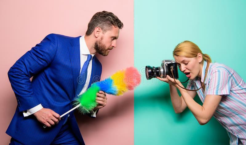 Picky and curious. Girl photographer capture every tiny dust. Focused on dust. Attentive reporter capture dirty. Reportage. Too much attention detail. Shooting royalty free stock photos