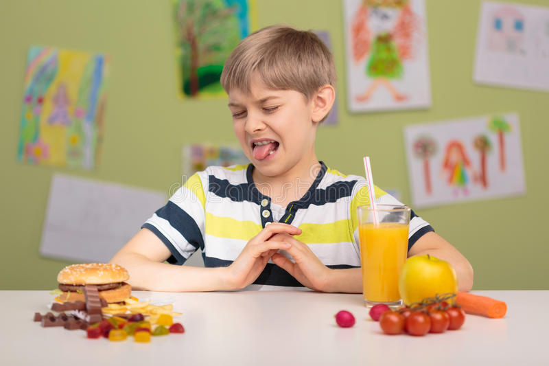 Picky eater and his diet. Photo of small picky eater and his diet stock images