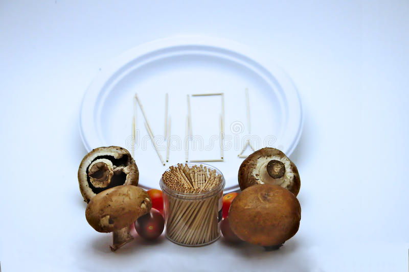 Picky Eater - Tomatoes and Mushrooms. Picky Eater - Tomatoes, Mushrooms. Concept of a picky eater is represented by toothpicks spelling out the word `NO` on a royalty free stock photos