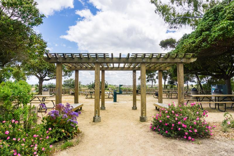 Picnic area, Palo Alto Baylands Park, California. Picnic area with tables, grills and water in Palo Alto Baylands Park, south San Francisco bay, California stock photography