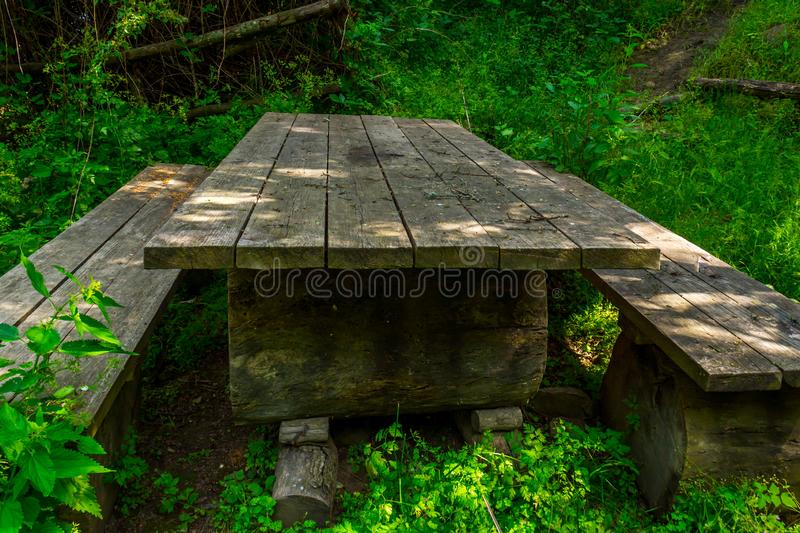 Picnic area. In a picturesque place, park, table, landscape, nature, trees, bench, green, travel, summer, outdoor, wood, wooden, outdoors, background, rest stock images
