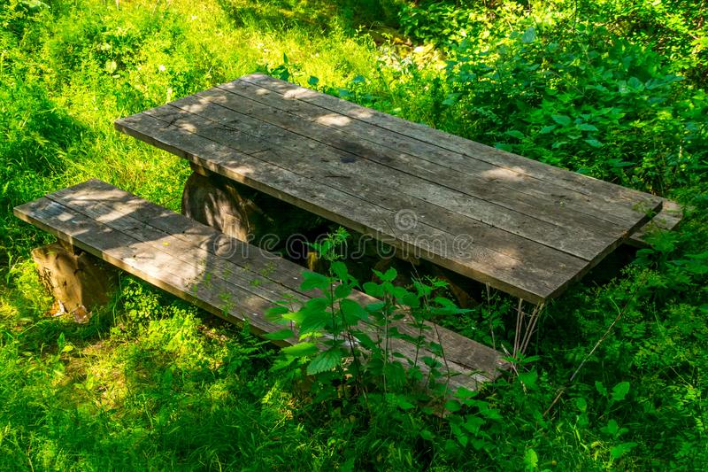 Picnic area. In a picturesque place, park, table, landscape, nature, trees, bench, green, travel, summer, outdoor, wood, wooden, outdoors, background, rest royalty free stock photos