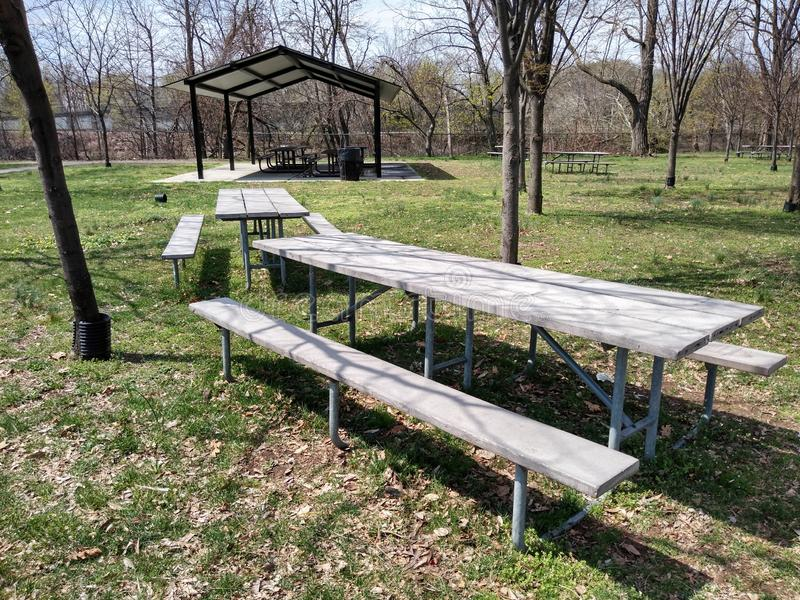 Picnic Area in a Public Park. Picnic area near the Passaic River in Memorial Park in Rutherford, NJ, USA. This photo was taken on April 13th 2019. picnic area stock photography