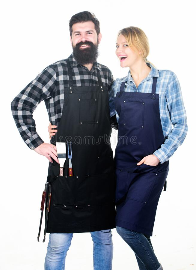 Picnic and barbecue. Backyard barbecue party. Family cooking grilled food. Cooking together. Couple in love getting. Ready for barbecue. Man bearded guy and stock photography