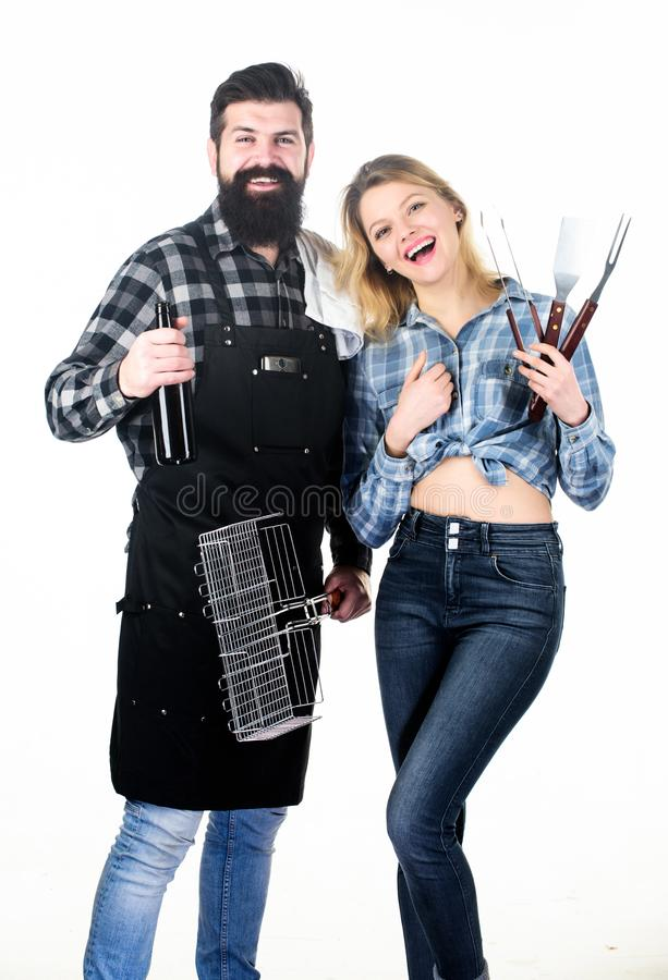 Picnic and barbecue. Bearded hipster and girl ready for barbecue party. Roasting and grilling food. Cooking together royalty free stock photo