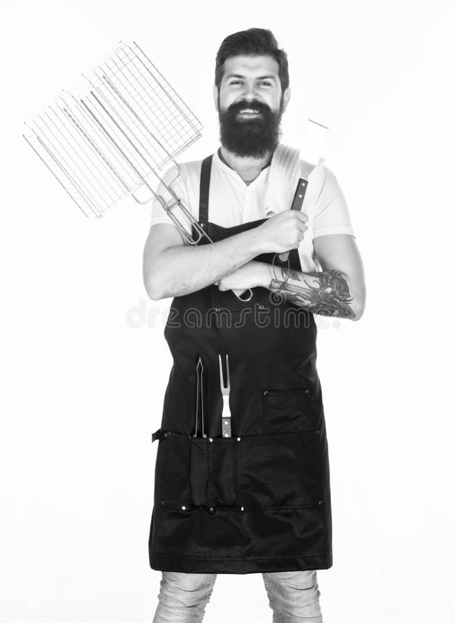 Picnic and barbecue. Bearded hipster wear apron for barbecue. Roasting and grilling food. Tips cooking meat. Tools for royalty free stock images