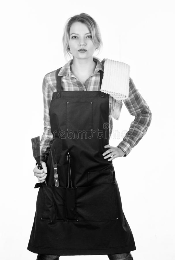 Picnic and barbecue. Cooking meat in park. Barbecue master. Grilling food. Woman checkered shirt and apron for cooking royalty free stock images