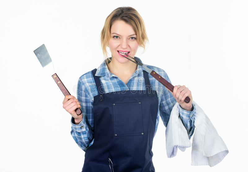 Picnic and barbecue. Cooking meat in park. Barbecue master. Woman checkered shirt and apron for cooking white background royalty free stock images