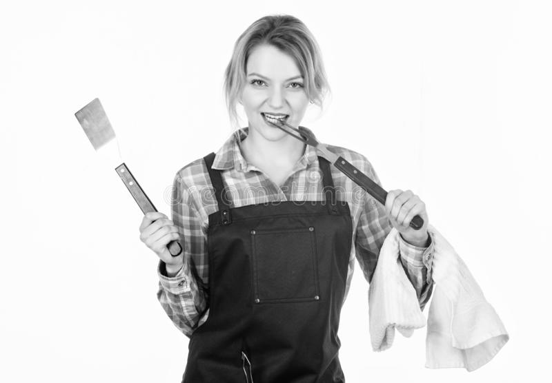 Picnic and barbecue. Cooking meat in park. Barbecue master. Woman checkered shirt and apron for cooking white background royalty free stock photos