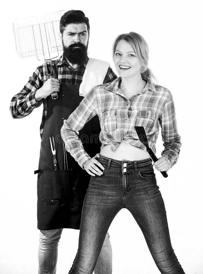 Picnic barbecue. food cooking. Family weekend. Couple in love hold kitchen utensils. Man bearded hipster and girl. Preparation and culinary. Tools for roasting stock images