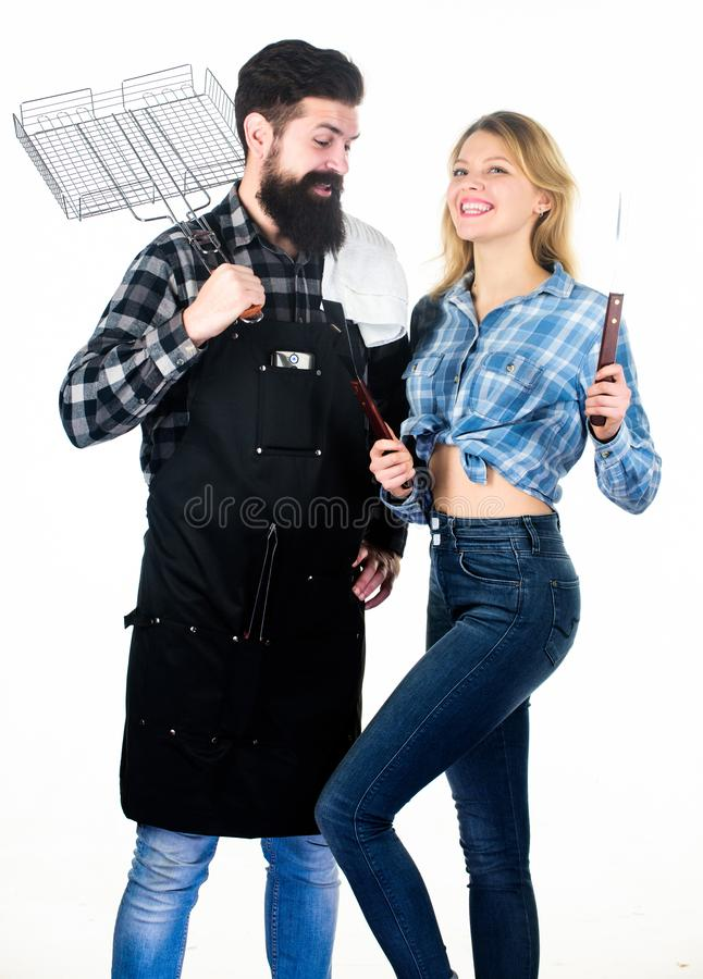 Picnic and barbecue. Man bearded hipster and girl ready for barbecue party. Culinary concept. Family weekend. Couple in royalty free stock images