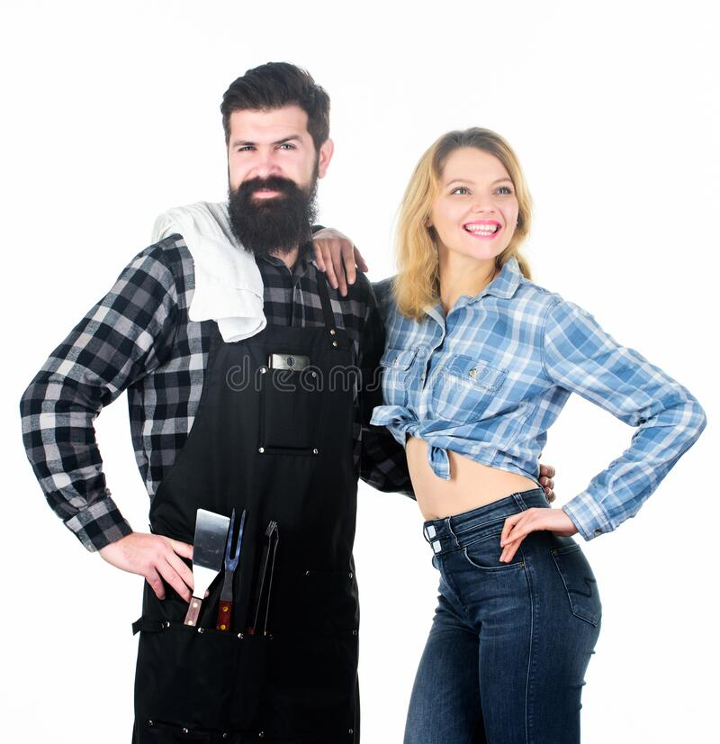 Picnic and barbecue. Man bearded hipster and girl ready for barbecue white background. Backyard barbecue party. Family. Bbq ideas. Delicious grilled recipes stock image