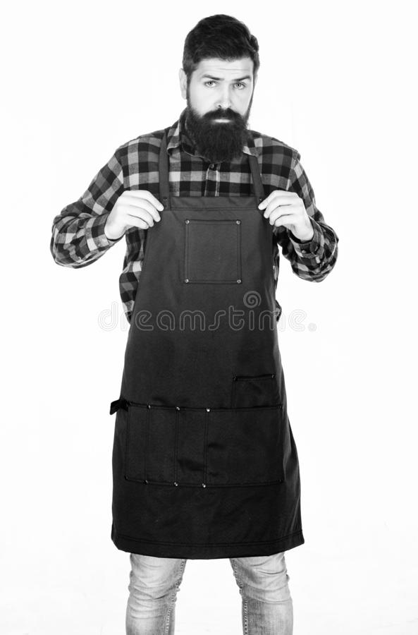 Picnic and barbecue. Man cook brutal hipster. Fast food restaurant. Serious bearded cook. Restaurant staff. Ready to. Cook. Bearded hipster wear apron for stock photo